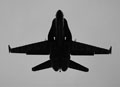 Silhouette of F-18 Blue Angel as he flies directly overhead